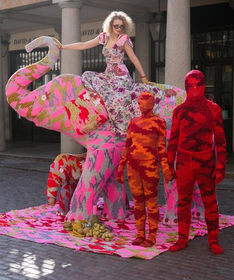 Olek on a crocheted elephant created to support Elephant Family, Convent Garden. Image courtesy of Elephant Family.