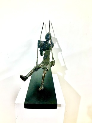 Reading on a swing by Usha Ramachandran, Art Deco Sculpture | 3D, Bronze, Spring Wood color