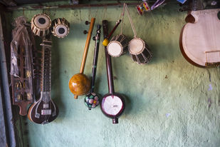Miniatures of various musical instruments by Ankit Agrawal, Image Photography, Digital Print on Archival Paper, Brown color