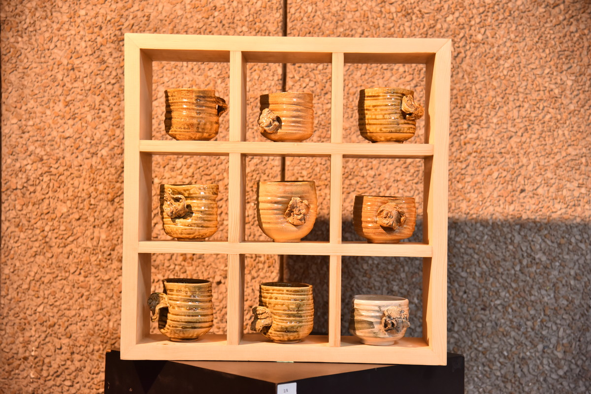 Wall Hanging of 9 bowls from solo series 'Undulations... Imprints of life on clay' by Shantanu Prakash, Art Deco Sculpture | 3D, Ceramic, Brown color