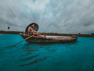 a man steer the boat in river by Arif Amin, Image Photography, Digital Print on Paper, Teal color